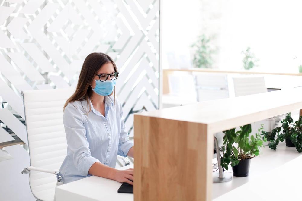 receptionist wearing mask